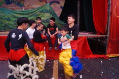 Shenzhen, China: young people dancing lion Stock Photo