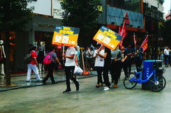 Shenzhen, China: young people to raise the banner of Internet advertising, publicity free Internet. Several young people to raise the banner of Internet royalty free stock photo