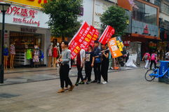 Shenzhen, China: young people to raise the banner of Internet advertising, publicity free Internet. Several young people to raise the banner of Internet royalty free stock image