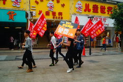 Shenzhen, China: young people to raise the banner of Internet advertising, publicity free Internet. Several young people to raise the banner of Internet stock image