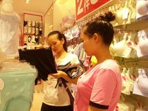 Shenzhen, China: young women buy Underwear Stock Photo