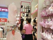 Shenzhen, China: young women buy Underwear Stock Image