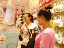 Shenzhen, China: young women buy Underwear Royalty Free Stock Images