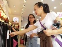 Shenzhen, China: young women buy Underwear Stock Images