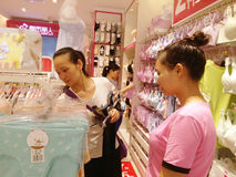 Shenzhen, China: young women buy Underwear Stock Photography