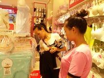 Shenzhen, China: young women buy Underwear Stock Photos