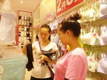 Shenzhen, China: young women buy Underwear Royalty Free Stock Photos