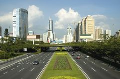 Shenzhen - city center. China, Guangdong province, Shenzhen - city center, general cityscape with modern skyscrapers and main road - Shennan Avenu Royalty Free Stock Photos