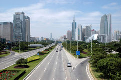 Shenzhen city - main avenue. China, Guangdong province, main avenue Shennan Road in Shenzhen city with modern skyscrapers, office buildings Stock Photos