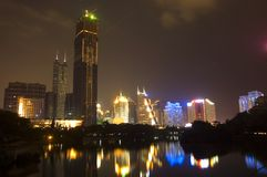 Shenzhen city by night. Nightscape - Shenzhen city center in Guangdong province, China. General cityscape with highest buildings and lake reflections Royalty Free Stock Photography