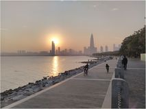 Shenzhen city and sunset. Sunset over the ocean with Shenzhen city in the background Royalty Free Stock Photography