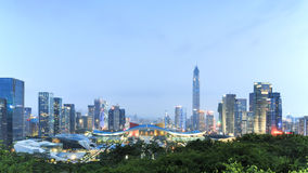 Shenzhen cityscape at dusk with the Civic Center and the Ping An IFC on foreground. Shenzhen, China - August 27,2015: Shenzhen cityscape at dusk with the Civic Stock Photos