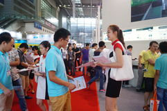 Shenzhen Convention and Exhibition Center: issuing advertising leaflets Stock Photo