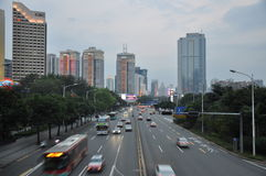 Shenzhen. In the evening, in shenzhen shennan avenue, present a busy scene on the tall buildings on both sides of the lights at the same time, give a person a Stock Image