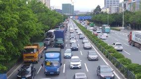 Shenzhen Kina: För vägbil för 107 medborgare landskap Arkivfoto