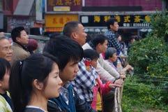 Shenzhen Kina: folk med handikapp i sjunga och tigga Arkivfoton