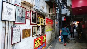Shenzhen Kina: Skyddsremsagravyr- och målningaffär arkivfoton
