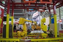 SHENZHEN, MARZEC - 30: Międzynarodowa maszynerii produkcja Zdjęcie Stock