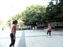 Chinese women kicking shuttlecock, exercise in the morning. Royalty Free Stock Images