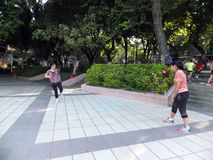 Chinese women kicking shuttlecock, exercise in the morning. Stock Images
