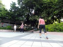 Chinese women kicking shuttlecock, exercise in the morning. Royalty Free Stock Photography