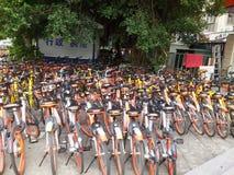 Shenzhen subway station entrance, dense sharing of bicycles Stock Photos