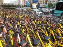 Shenzhen subway station entrance, dense sharing of bicycles Stock Photo