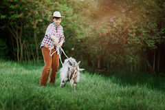 The Shepherd Boy puts the lasso on the goat royalty free stock image