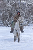 Shepherd or cowboy rides horse on the winter snowy forest on Novemer 1, 2016 Altai, Russia Stock Photography