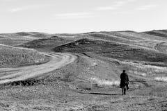 Shepherd on a horse. Desert gareji on the way Stock Photography