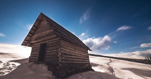 Shepherd house in winter mountains at full moon stock video