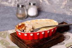 Shepherd pie on white wooden desk Royalty Free Stock Photography