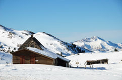 Shepherd's house on the snow slope in mountains Royalty Free Stock Photography