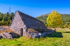 Shepherd`s houses in Bosnia. Shepherd`s houses in nature park Blidinje, mountain Čvrsnica in Bosnia and Herzegovina. Old stone houses now are used for sheep Royalty Free Stock Images
