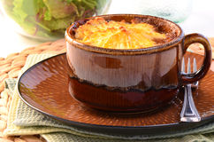 Shepherd's pie. Hot from the oven homemade shepherd's pie with cheesy mashed potatoes in small casserole dish Stock Images
