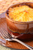 Shepherd's pie. Hot from the oven homemade shepherd's pie with cheesy mashed potatoes in small casserole dish Royalty Free Stock Photography