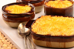 Shepherd's pie. Hot from the oven homemade shepherd's pie with cheesy mashed potatoes in small casserole dishes Royalty Free Stock Image
