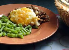 Shepherd's Pie. Hot from the oven, served with green beans royalty free stock photos