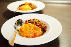 Shepherd`s pie. Shepherd`s pie plating. Meat sauce, mashed potatoes, egg and cheese royalty free stock photo