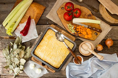 Shepherd`s pie traditional english dish. Top view. Dinner table Stock Image