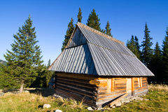 Shepherd wooden hut on meadow Stock Photos