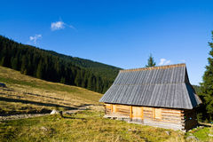 Shepherd wooden hut on meadow Stock Photo