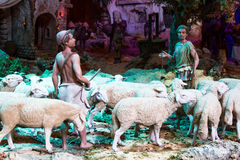 Shepherds with a herd of sheep. Two shepherds with a herd of sheep at night Stock Photo