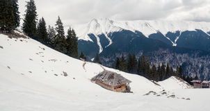 Shepherds hut in the mountains. Winter scape in Fagaras mountains stock photography