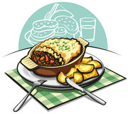 Shepherds meat pie. Traditional english shepherds meat pie and fried potatoes Royalty Free Stock Images