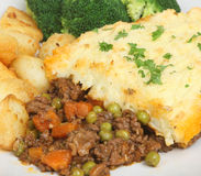 Shepherds Pie. Served with sauteed potatoes and broccoli Stock Images