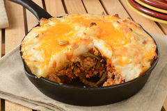 Shepherds pie in a cast iron skillet. Shepherds pie served in a cast iron skillet Stock Images