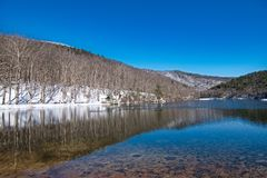 Sherando Lake Recreation Area Scenic Landscape. Sunny Winter Day after Snow with reflection of mountain in lakes while recreational hiking at campground beach stock image