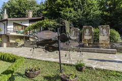 SHERBA, BULGARIA, AUGUST 10 2015, two bikes and some very famous. SHERBA, BULGARIA, AUGUST 10 2015, three stone bust and some very famous sentences of famous Royalty Free Stock Photography