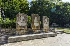SHERBA, BULGARIA, AUGUST 10 2015, two bikes and some very famous. SHERBA, BULGARIA, AUGUST 10 2015, three stone bust and some very famous sentences of famous stock photo
